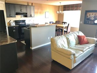 Photo 7: 821 AUBURN BAY BV SE in Calgary: Auburn Bay House for sale : MLS®# C4125470