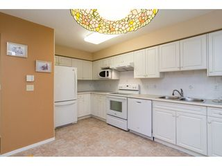 "Photo 11: 106 13860 70 Avenue in Surrey: East Newton Condo for sale in ""Chelsea Gardens"" : MLS®# R2243346"