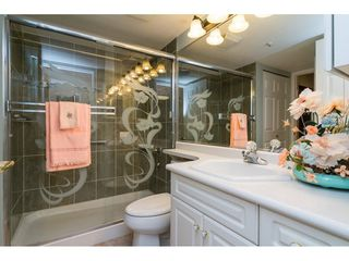 "Photo 9: 106 13860 70 Avenue in Surrey: East Newton Condo for sale in ""Chelsea Gardens"" : MLS®# R2243346"