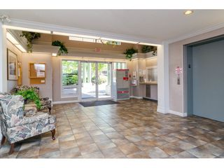 "Photo 3: 106 13860 70 Avenue in Surrey: East Newton Condo for sale in ""Chelsea Gardens"" : MLS®# R2243346"