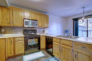 Photo 9: 7 PINEBROOK Place NE in Calgary: Pineridge Detached for sale : MLS®# C4221689