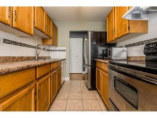 "Photo 8: 213 9952 149 Street in Surrey: Guildford Condo for sale in ""Tall Timbers"" (North Surrey)  : MLS®# R2366920"