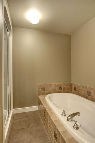 Photo 21: 5202 400 EAU CLAIRE Avenue SW in Calgary: Eau Claire Row/Townhouse for sale : MLS®# A1018228