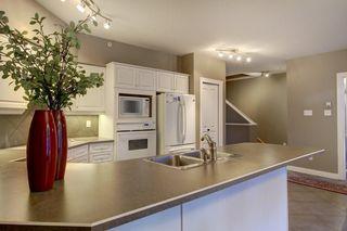 Photo 7: 5202 400 EAU CLAIRE Avenue SW in Calgary: Eau Claire Row/Townhouse for sale : MLS®# A1018228