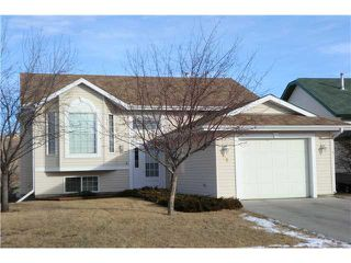 Photo 1: 58 WEST MCDOUGAL Road: Cochrane Residential Detached Single Family for sale : MLS®# C3501046