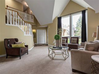 Photo 6: 440 COACH LIGHT Bay SW in Calgary: Coach Hill House for sale : MLS®# C4017469