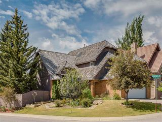 Photo 2: 440 COACH LIGHT Bay SW in Calgary: Coach Hill House for sale : MLS®# C4017469