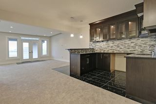 Photo 25: 236 Kinniburgh Circle in Chestermere: House for sale : MLS®# C4013330