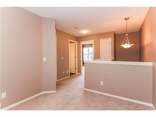 Photo 15: 136 EVERSYDE Boulevard SW in Calgary: Evergreen House for sale : MLS®# C4081553