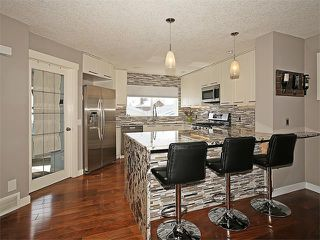 Photo 2: 7 TUSCANY RIDGE Terrace NW in Calgary: Tuscany House for sale : MLS®# C4112898
