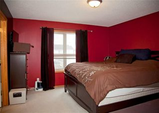 Photo 19: 48 CIMARRON MEADOWS Road: Okotoks House for sale : MLS®# C4174831