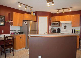 Photo 8: 48 CIMARRON MEADOWS Road: Okotoks House for sale : MLS®# C4174831