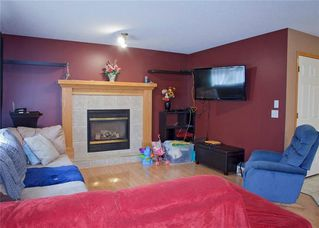 Photo 14: 48 CIMARRON MEADOWS Road: Okotoks House for sale : MLS®# C4174831