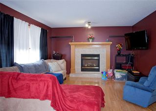 Photo 13: 48 CIMARRON MEADOWS Road: Okotoks House for sale : MLS®# C4174831
