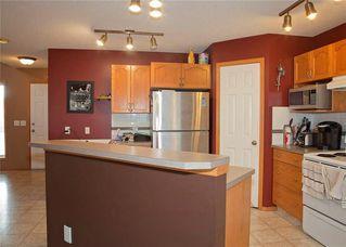 Photo 9: 48 CIMARRON MEADOWS Road: Okotoks House for sale : MLS®# C4174831