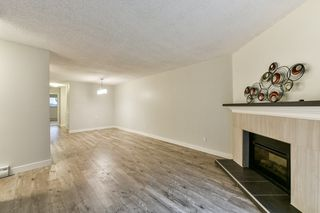 """Main Photo: 10592 HOLLY PARK Lane in Surrey: Guildford Townhouse for sale in """"Holly Park Lane"""" (North Surrey)  : MLS®# R2329414"""