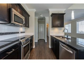 "Main Photo: 401 11862 226 Street in Maple Ridge: East Central Condo for sale in ""SIGNATURE AT FALCON CENTRE"" : MLS®# R2455925"