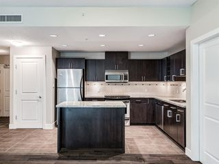 Photo 4: 2101 77 SPRUCE Place SW in Calgary: Spruce Cliff Apartment for sale : MLS®# A1056300