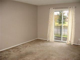 Photo 8: 220 50 Avenue: Claresholm Semi Detached for sale : MLS®# C4048339