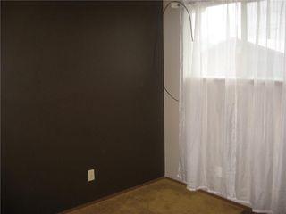 Photo 4: 220 50 Avenue: Claresholm Semi Detached for sale : MLS®# C4048339