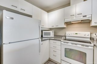 "Photo 2: 207 2355 W BROADWAY in Vancouver: Kitsilano Condo for sale in ""CONNAUGHT PARK PLACE"" (Vancouver West)  : MLS®# R2140254"