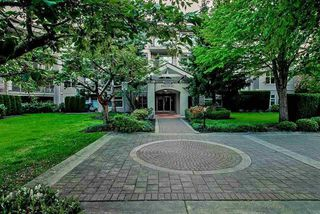 "Photo 1: 105 15220 GUILDFORD Drive in Surrey: Guildford Condo for sale in ""THE BOULEVARD"" (North Surrey)  : MLS®# R2142618"