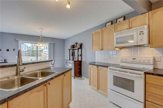 Photo 3: 180 BRIDLEPOST Green SW in Calgary: Bridlewood House for sale : MLS®# C4181194