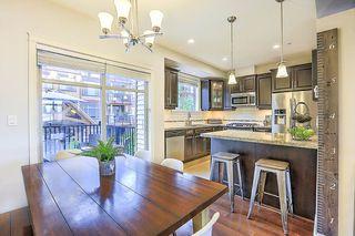 "Photo 1: 9 12585 190A Street in Pitt Meadows: Mid Meadows Townhouse for sale in ""Cedar Downs"" : MLS®# R2275726"