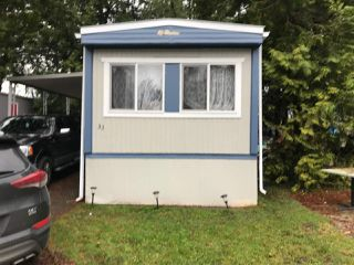 """Photo 1: 33 6571 KING GEORGE Boulevard in Surrey: West Newton Manufactured Home for sale in """"Newton Park"""" : MLS®# R2328586"""