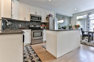 "Photo 1: 38 12775 63 Avenue in Surrey: Panorama Ridge Townhouse for sale in ""Enclave"" : MLS®# R2470117"
