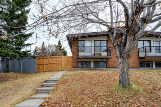 Photo 1: 11146 Sacramento Drive SW in Calgary: Southwood Semi Detached for sale : MLS®# A1048921