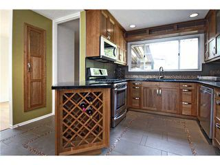 Photo 4: 2112 LANGRIVILLE Drive SW in CALGARY: North Glenmore Residential Detached Single Family for sale (Calgary)  : MLS®# C3587862