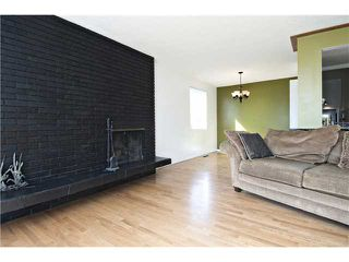 Photo 10: 2112 LANGRIVILLE Drive SW in CALGARY: North Glenmore Residential Detached Single Family for sale (Calgary)  : MLS®# C3587862