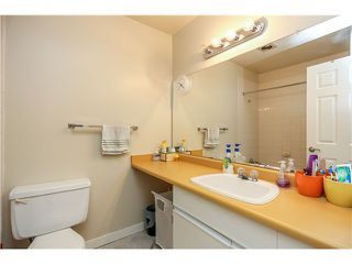 "Photo 11: 10531 HOLLY PARK LN in Surrey: Guildford Townhouse for sale in ""HOLLY PARK"" (North Surrey)  : MLS®# F1404080"