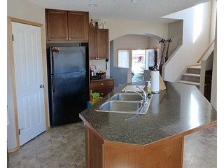Photo 4: 183 COVECREEK Place NE in Calgary: Coventry Hills Residential Detached Single Family for sale : MLS®# C3638239