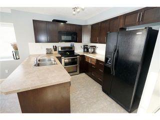 Photo 6: 55 105 DRAKE LANDING Common: Okotoks House for sale : MLS®# C4096835