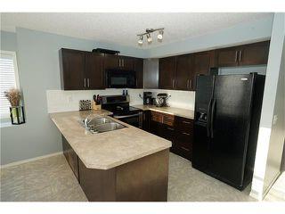 Photo 5: 55 105 DRAKE LANDING Common: Okotoks House for sale : MLS®# C4096835