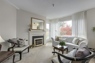 "Photo 2: 301 2010 W 8TH Avenue in Vancouver: Kitsilano Condo for sale in ""AUGUSTINE GARDENS"" (Vancouver West)  : MLS®# R2319806"