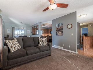 Photo 3: 12 140 STRATHAVEN Circle SW in Calgary: Strathcona Park Semi Detached for sale : MLS®# C4229318