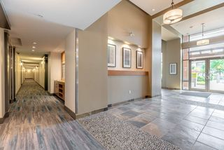 """Photo 16: 101 300 KLAHANIE Drive in Port Moody: Port Moody Centre Condo for sale in """"TIDES"""" : MLS®# R2375943"""