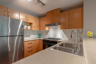 """Photo 7: 101 300 KLAHANIE Drive in Port Moody: Port Moody Centre Condo for sale in """"TIDES"""" : MLS®# R2375943"""