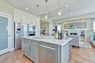Photo 1: 2 8050 Orchards Green in Edmonton: Zone 53 House Half Duplex for sale : MLS®# E4161869