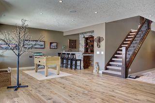 Photo 31: 87 WEST POINTE Manor: Cochrane Detached for sale : MLS®# C4256427