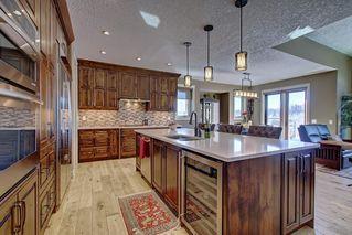 Photo 12: 87 WEST POINTE Manor: Cochrane Detached for sale : MLS®# C4256427