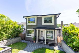 Photo 1: 3654 E PENDER Street in Vancouver: Renfrew VE House for sale (Vancouver East)  : MLS®# R2389881
