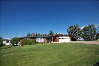 Main Photo: 7008 Deer Street in Lacombe: College Heights Residential for sale : MLS®# CA0193406