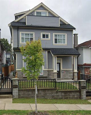 Photo 1: 2340 E 33RD Avenue in Vancouver: Collingwood VE House 1/2 Duplex for sale (Vancouver East)  : MLS®# R2494427