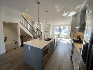 Photo 11: 308 30 Avenue NE in Calgary: Tuxedo Park Semi Detached for sale : MLS®# C4273356