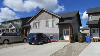 "Main Photo: 8316 87 Avenue in Fort St. John: Fort St. John - City SE 1/2 Duplex for sale in ""ENERGY PARK"" (Fort St. John (Zone 60))  : MLS®# R2486890"
