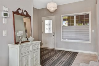 Photo 5: 583 Everbrook Way SW in Calgary: Evergreen Detached for sale : MLS®# A1033176